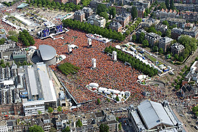 Human Being Photograph - Koninginnedag Or Queens Day, Amsterdam by Bram van de Biezen