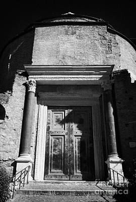 Damian Photograph - Large Bronze Doors To The Entrance Of The Temple Of Romulus Now A Church Santi Cosma E Damiano In The Imperial Roman Forum Rome Lazio Italy by Joe Fox