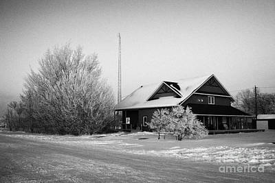 large residential traditional house with communications mast in rural village Forget Saskatchewan  Print by Joe Fox