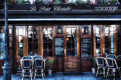 Pause Photograph - Le Petit Chatelet Paris France by Evie Carrier