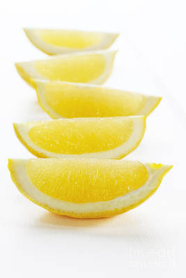 Lemon Wedges On White Background Print by Colin and Linda McKie