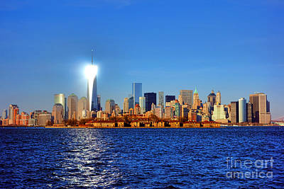 Ellis Photograph - Lighthouse Manhattan by Olivier Le Queinec