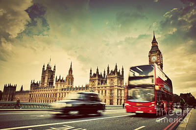Icon Photograph - London The Uk Red Bus Taxi Cab In Motion And Big Ben by Michal Bednarek