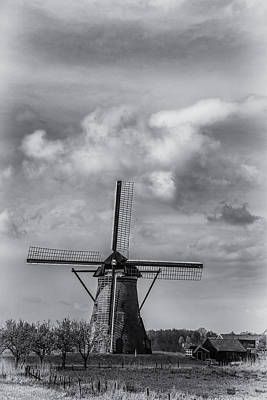 Tiare Photograph - Lone Windmill At Kinderdijk Holland by James Bethanis