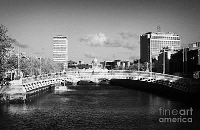 Looking Down The Liffey Towards The Hapenny Ha Penny Bridge Over The River Liffey In Dublin Print by Joe Fox