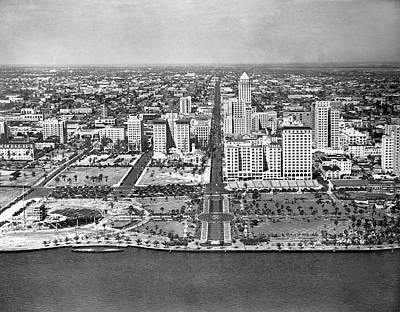 High Street Photograph - Looking Up Flagler Street At Downtown Miami by Underwood Archives