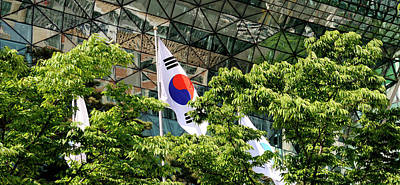 Seoul Photograph - Low Angle View Of Flags And Trees by Panoramic Images