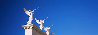 Angel Blues Photograph - Low Angle View Of Statues On A Wall by Panoramic Images