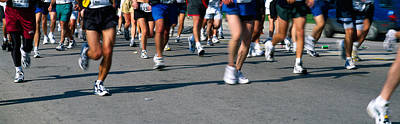 Low Section View Of People Running Print by Panoramic Images