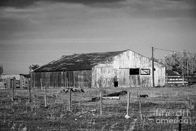 low wooden barn on farm in rural Canada Print by Joe Fox