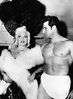 Mae West, Left, And One Of Her Muscle Print by Everett