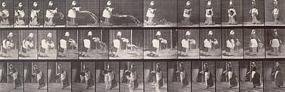 Eadwerd Photograph - Maid Throwing A Bucket Of Water by Eadweard Muybridge