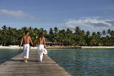 Maldives, Couple Walking On Pier � Print by Tips Images