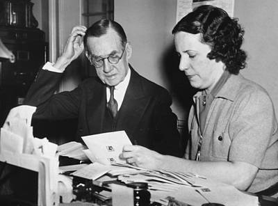 Contemplate Photograph - Man Assisted By His Secretary by Underwood Archives