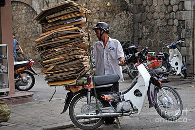 Man Carrying Cardboard On The Back Of His Scooter Print by Sami Sarkis
