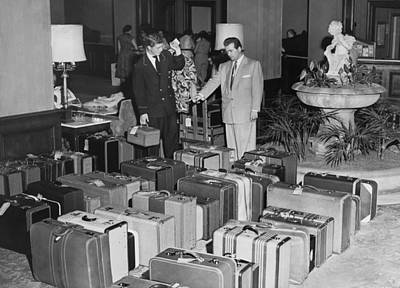 Helping Photograph - Man In Lobby With Suitcases by Underwood Archives