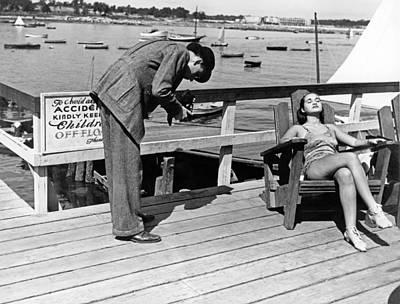 Sunbathers Photograph - Man Photographs Sleeping Girl by Underwood Archives