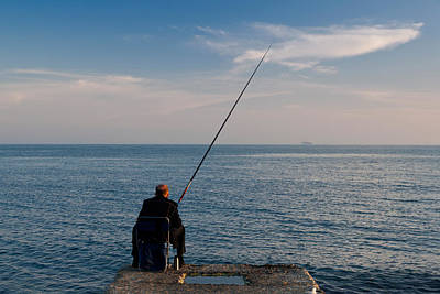 Enjoyment Photograph - Man Pier Fishing, Lighthouse Beach by Panoramic Images