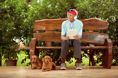 Man Sitting On Bench With Dogs Print by Ktsdesign