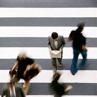 Man Walking And Reading Newspaper On Zebra Crossing Print by Juan Carlos Ferro Duque