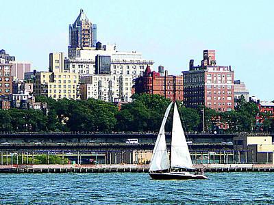 Skyscrapers Photograph - Manhattan - Sailboat Against Manhatten Skyline by Susan Savad