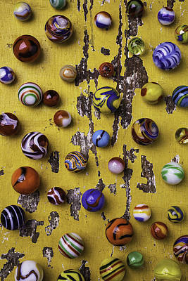 Marbles On Yellow Wooden Table Print by Garry Gay