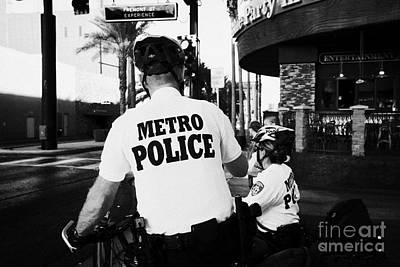 metro police bicycle cops in downtown Las Vegas Nevada USA Print by Joe Fox
