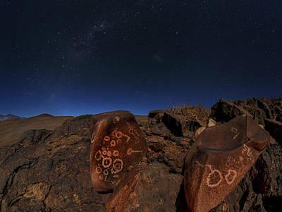 Milky Way Over Petroglyphs Print by Babak Tafreshi
