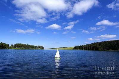 Miniature Sailboat In The Middle Of A Lake Print by Bernard Jaubert