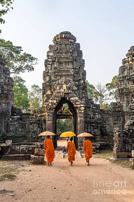 Angkor Photograph - Monks With Umbrella Walking Into Angkor Wat Temple - Cambodia by Matteo Colombo