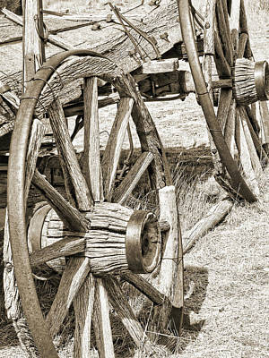 Old West Photograph - Montana Old Wagon Wheels In Sepia by Jennie Marie Schell