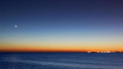 Venusian Photograph - Moon And Venus At Sunrise by Luis Argerich