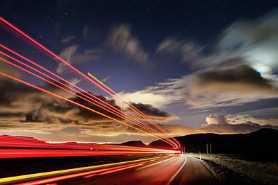 Moonlit Night Photograph - Moonlight And Light Trails by Babak Tafreshi