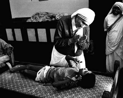 Mother Teresa Helping Boy Print by Retro Images Archive