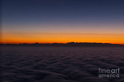 Sunset Photograph - Mountain Silhouette Over Sea Of Clouds by Darcy Michaelchuk