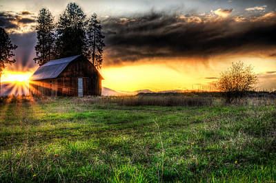 Mountain Sun Behind Barn Print by Derek Haller
