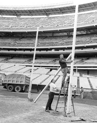 New York Jets Football Crew Works On Field Goal Repairs Print by Retro Images Archive