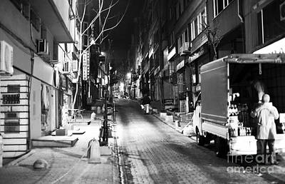 Night Delivery In Istanbul Print by John Rizzuto