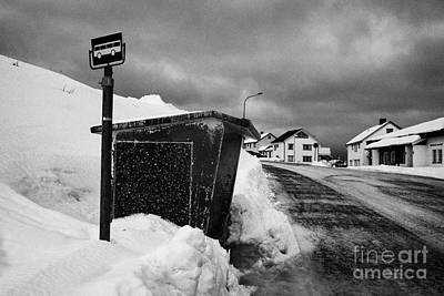 norwegian bus stop shelter covered in snow by the side of the road Honningsvag finnmark norway europ Print by Joe Fox