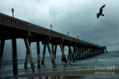 Flying Seagull Photograph - Oean Pier - Surreal Stormy Blue Pier Beach Ocean Fishing Pier With Seagull by Kathy Fornal