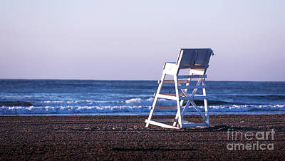 Empty Chairs Photograph - Off Duty by John Rizzuto