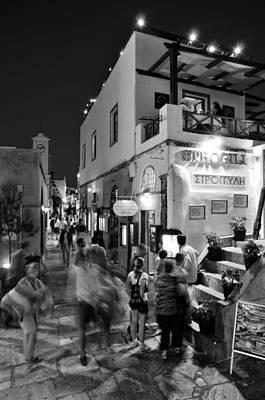 Street Photograph - Oia Town By Night by George Atsametakis