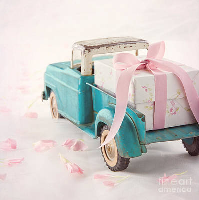 Old Antique Toy Truck Carrying A Gift Box With Pink Ribbon Print by Anna-Mari West