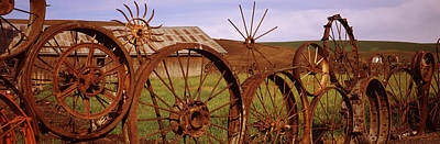 Built Structure Photograph - Old Barn With A Fence Made Of Wheels by Panoramic Images