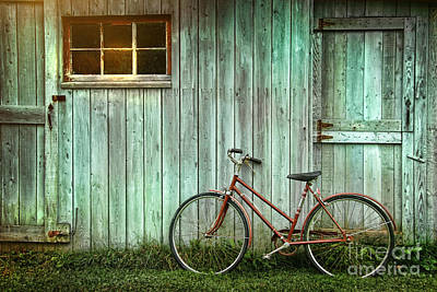 Old Bicycle Leaning Against Grungy Barn Print by Sandra Cunningham