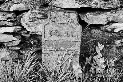 Benchmark Photograph - old cast iron bench mark in feet and inches on the roadside of the A6 cumbria uk by Joe Fox