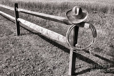 Old Cowboy Hat On Fence Print by Olivier Le Queinec