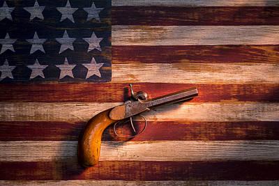 Rusted Barrels Photograph - Old Gun On Folk Art Flag by Garry Gay
