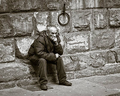 Stone Buildings Photograph - Old Man Pondering by Susan Schmitz