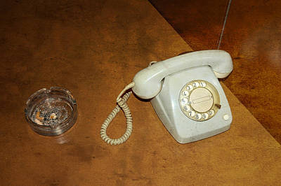 Old Telephone And Ashtray On Brown Table Print by Matthias Hauser